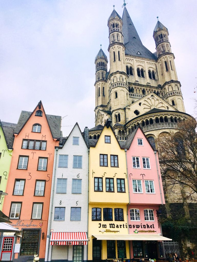 colourful houses in front of a church