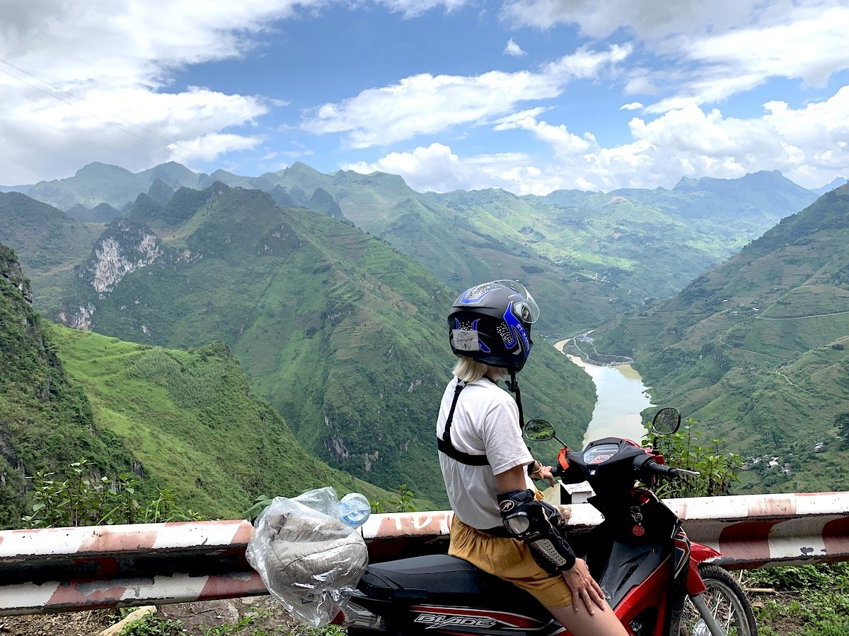 Motorcyclist looking over the mountains in Ha Giang