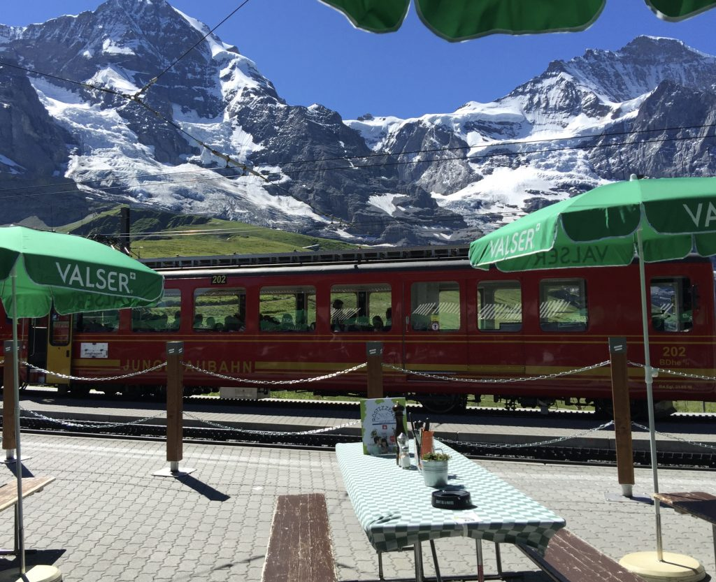 Red Train stopped at a restaurant in Jungfrau