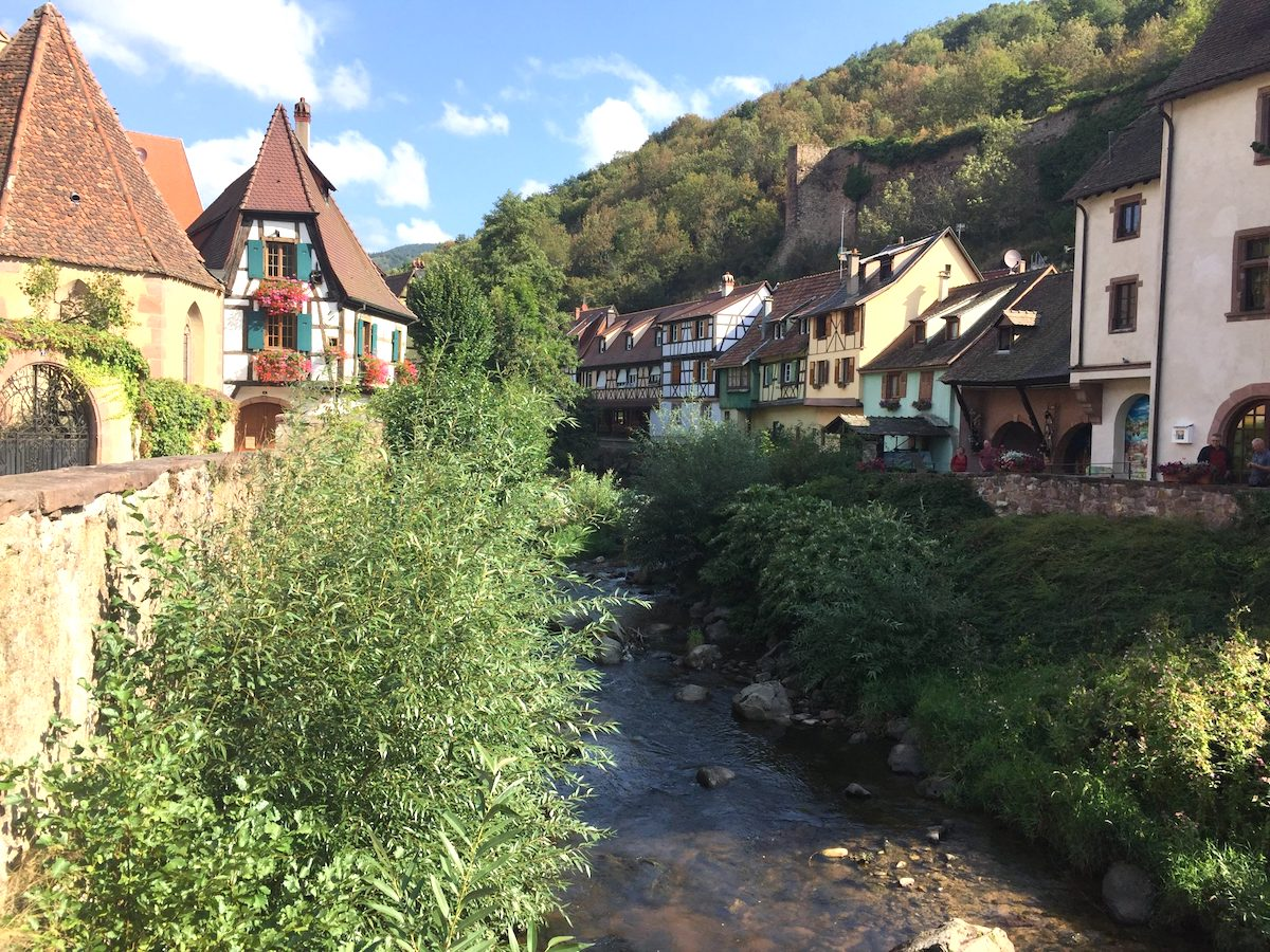 Quaint timbered buildings alongside a stream