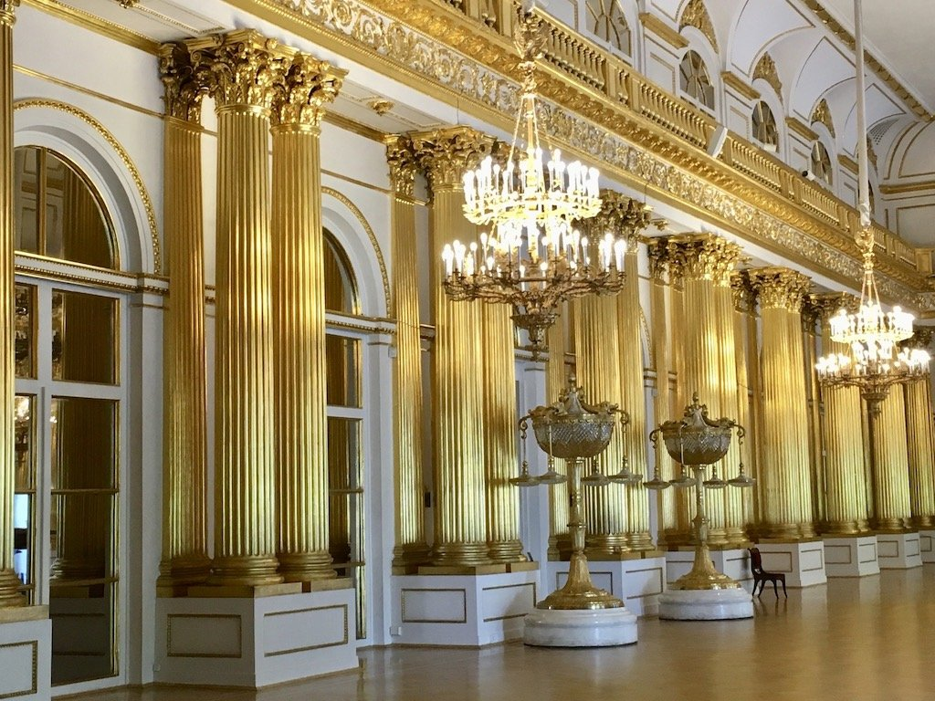 Gold Columns and crystal chandeliers inside the Hermitage Museum