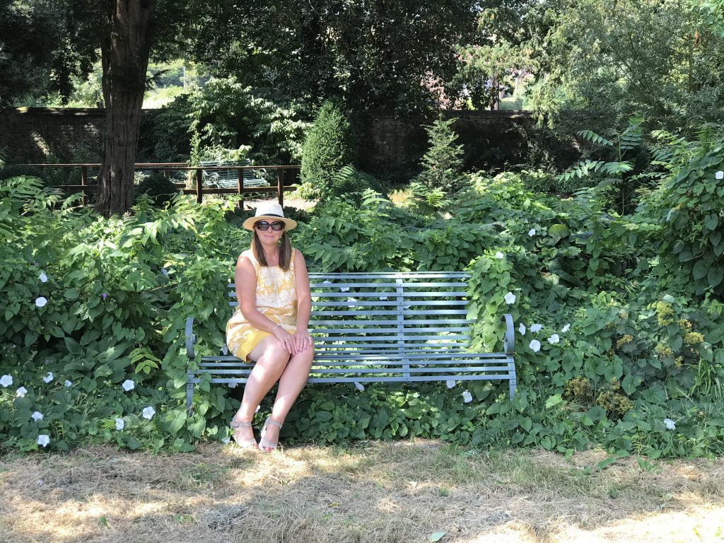 Angie sitting on a seat in Spring Garden
