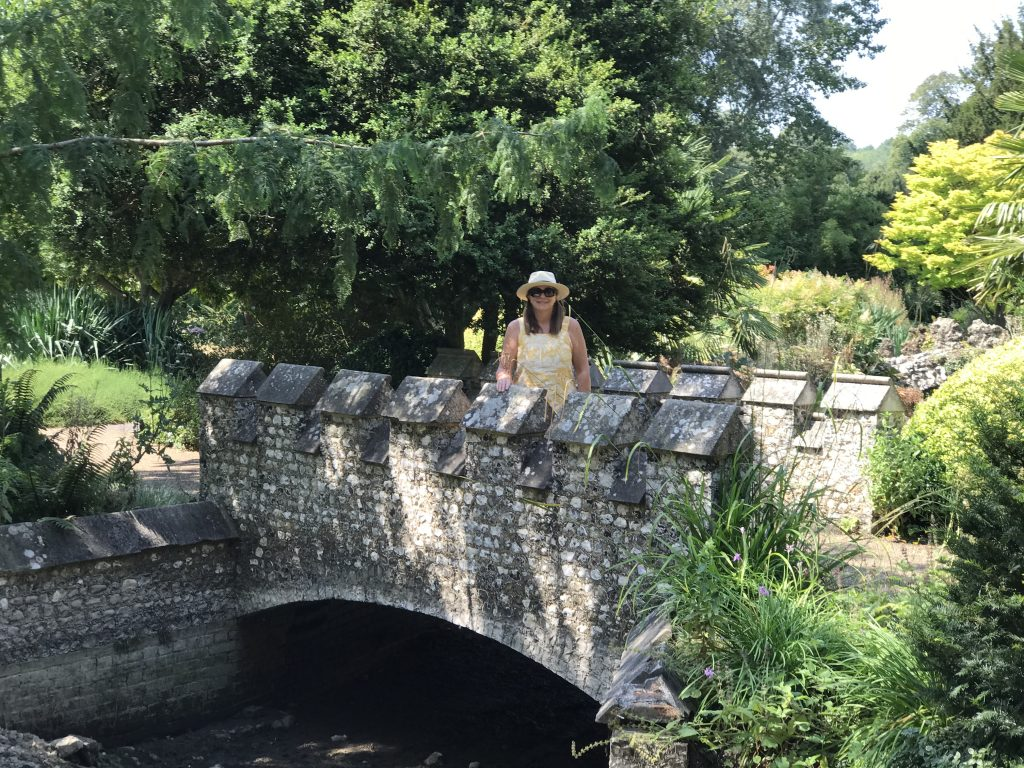 Angie standing on a flint bridge