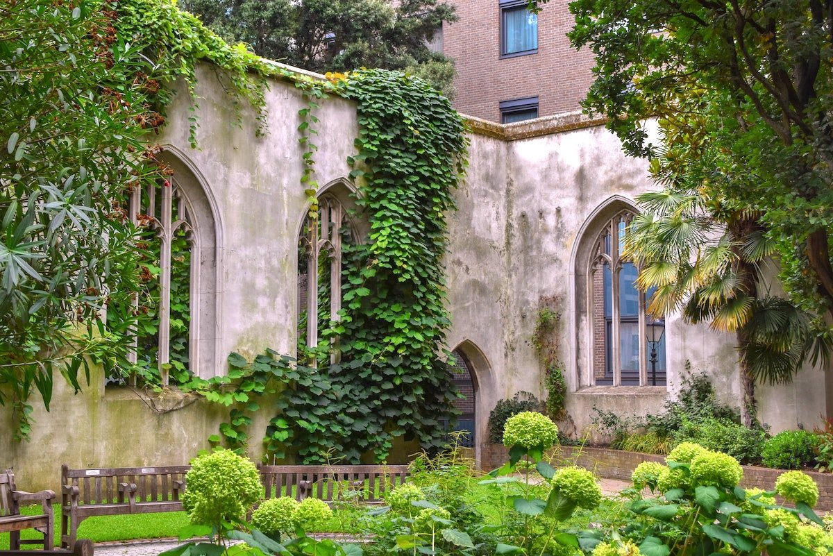 church ruins covered by climbing foliage