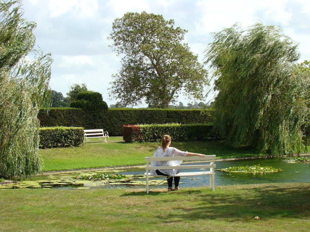 Angie sitting by the lily pond