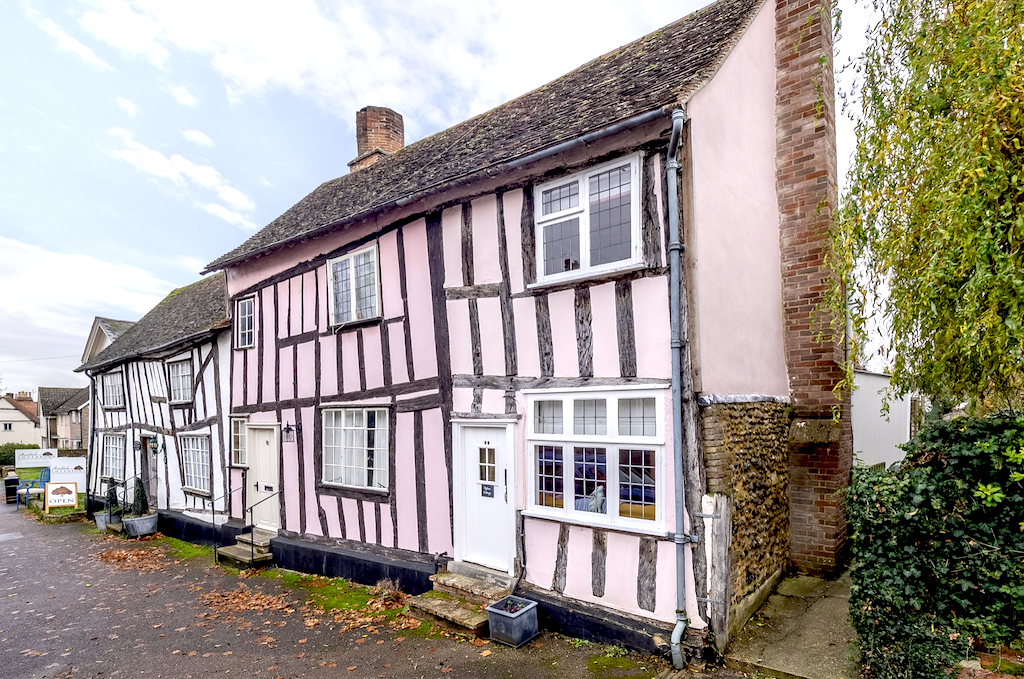 A pink timbered Suffolk cottages