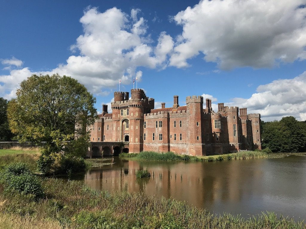 A view of Herstmonceux castle sitting in the moat