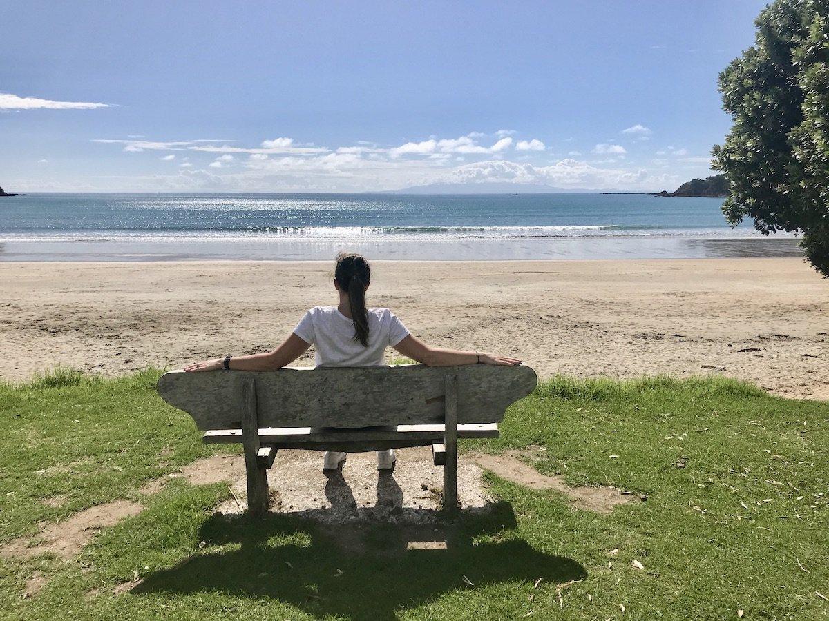 Angie sitting on Oneroa Beach