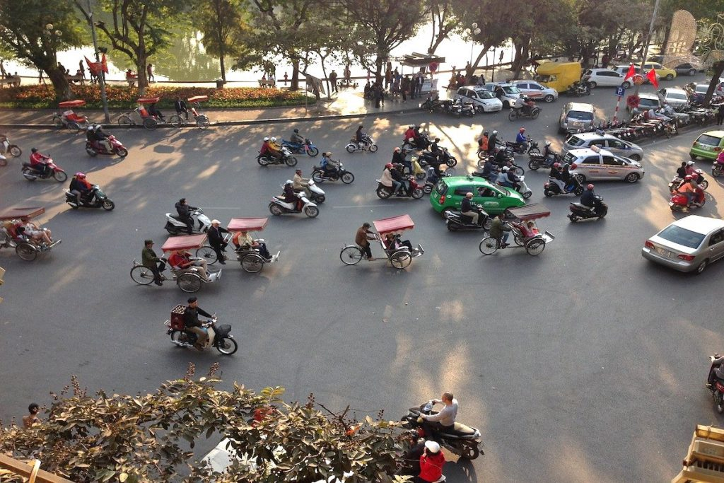 Motorbikes and cars on the roundabout in Hanoi