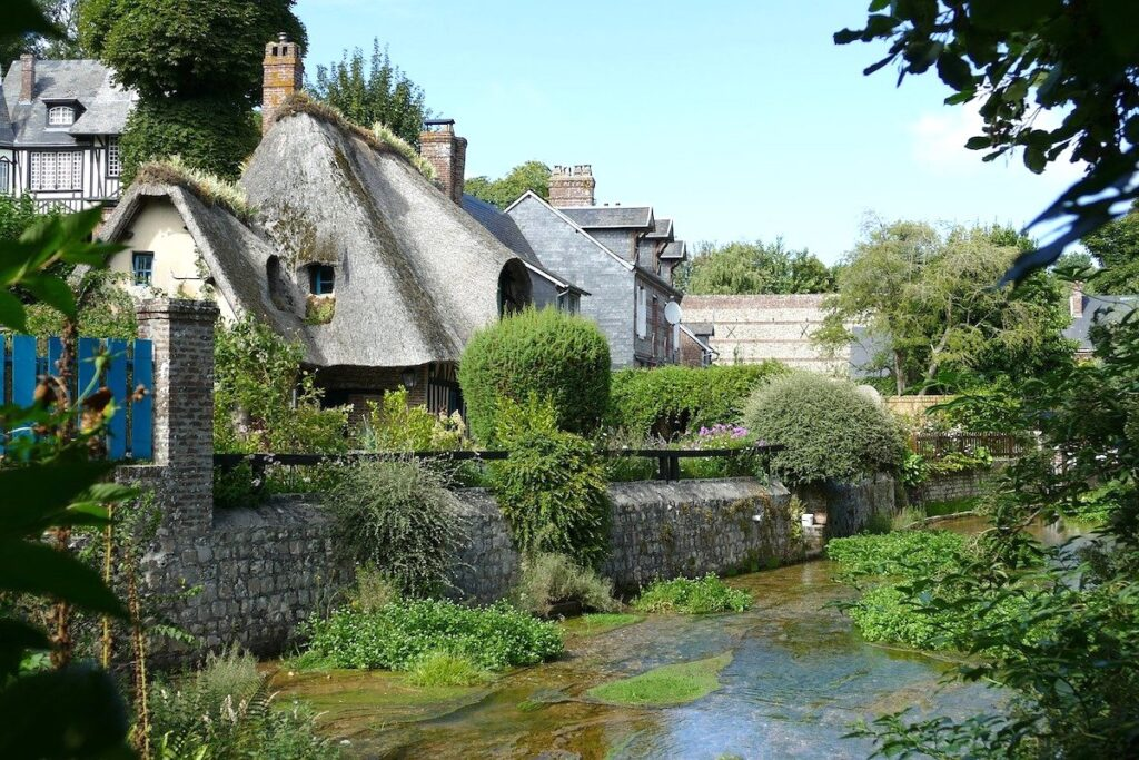 Thatched cottage by river in Northern France