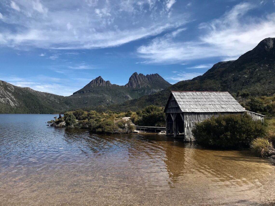 Wooden boathouse on the edge of Dove Lake with Cradle Mountain in the background
