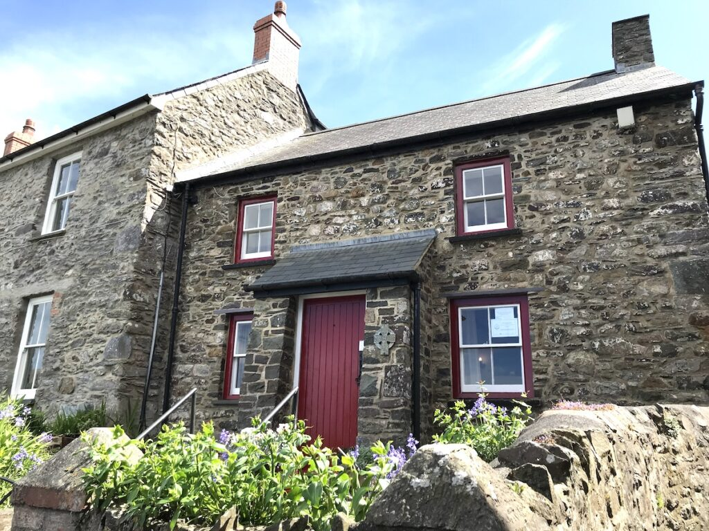 St David's cobble stone house with a red door