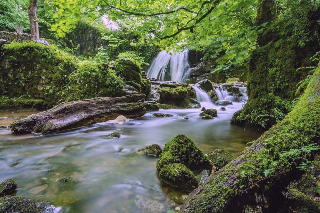 Janets Foss Waterfall in Malham, Yorkshire. Situated in dense woodland and cascading around 100 feet down