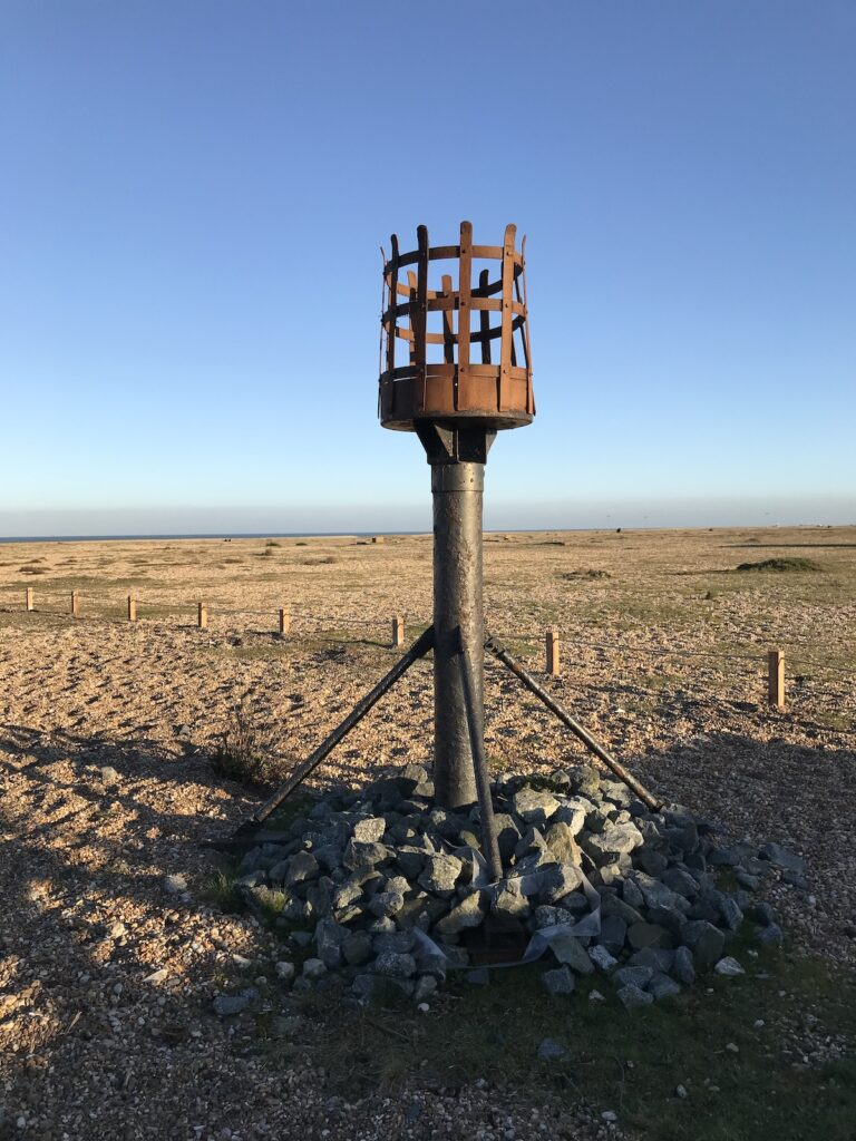 A rusted beacon on the shingle beach at Dungeness