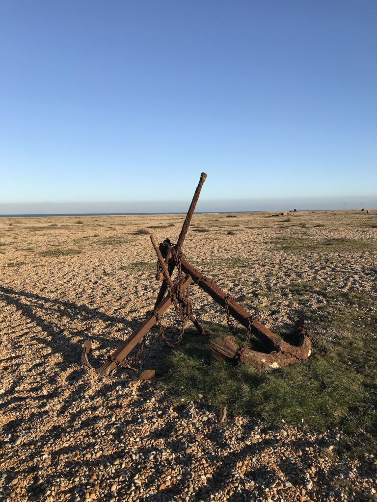 A rusted anchor that is on the beach at Dungeness
