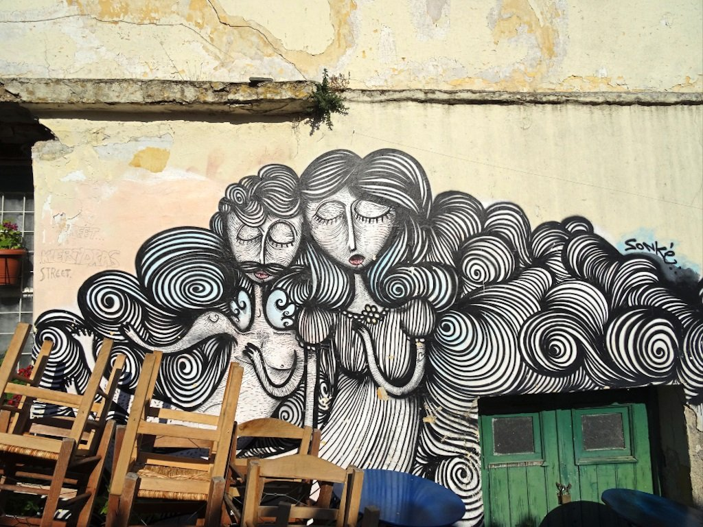 street art depicting a girl with curly hair