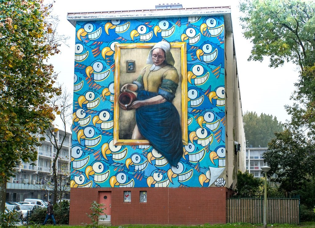 A mural of a Flemish woman with cartoon characters around her