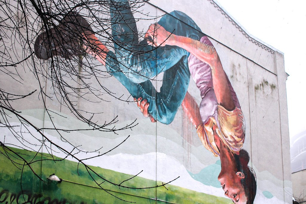 Street Art depicting an upside-down girl on a wall