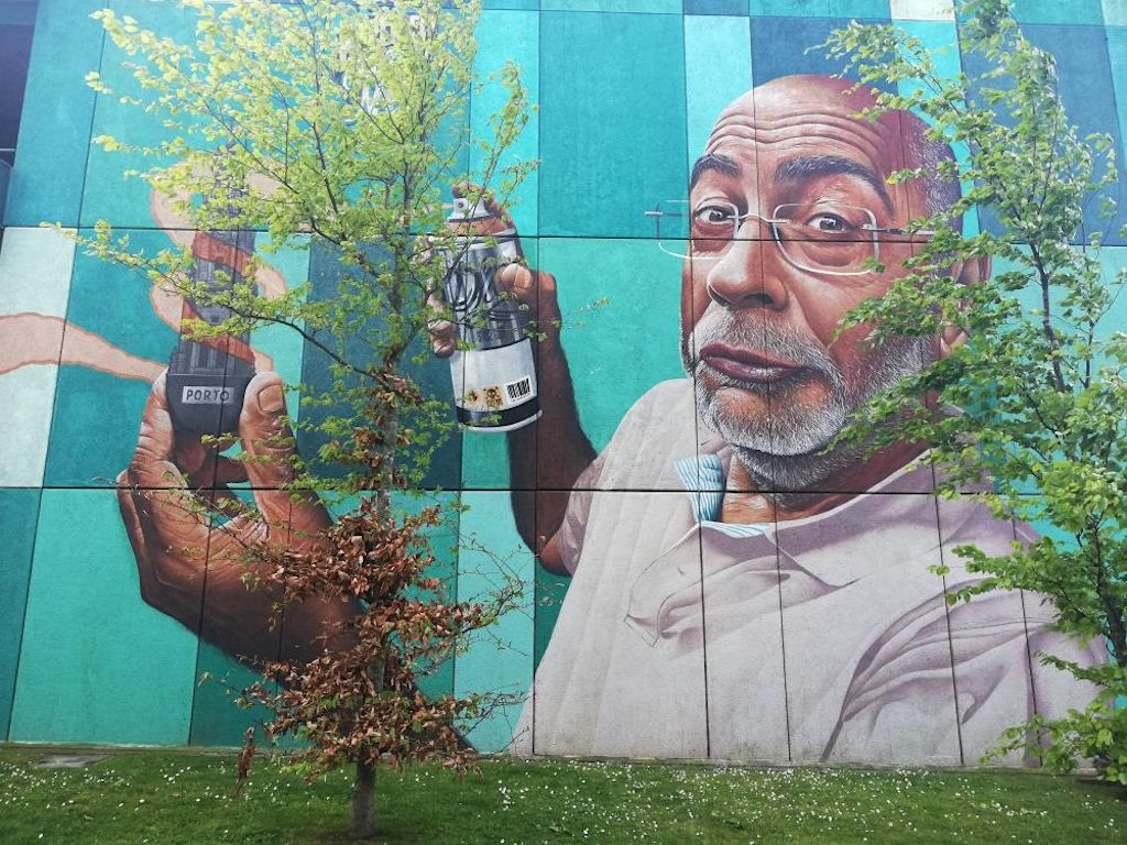a wall mural of a man wearing glasses