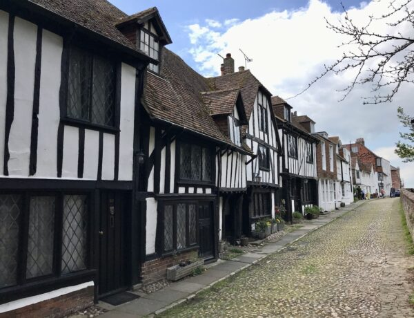 A row of black and white half timbered houses along a cobbled street in Rye