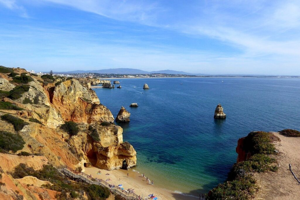 A spectacular Portugal coastal scene of the Algarve with blue waters and rocky outcrops