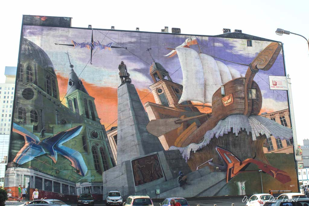 Street art depicting a ship and towers in Poland