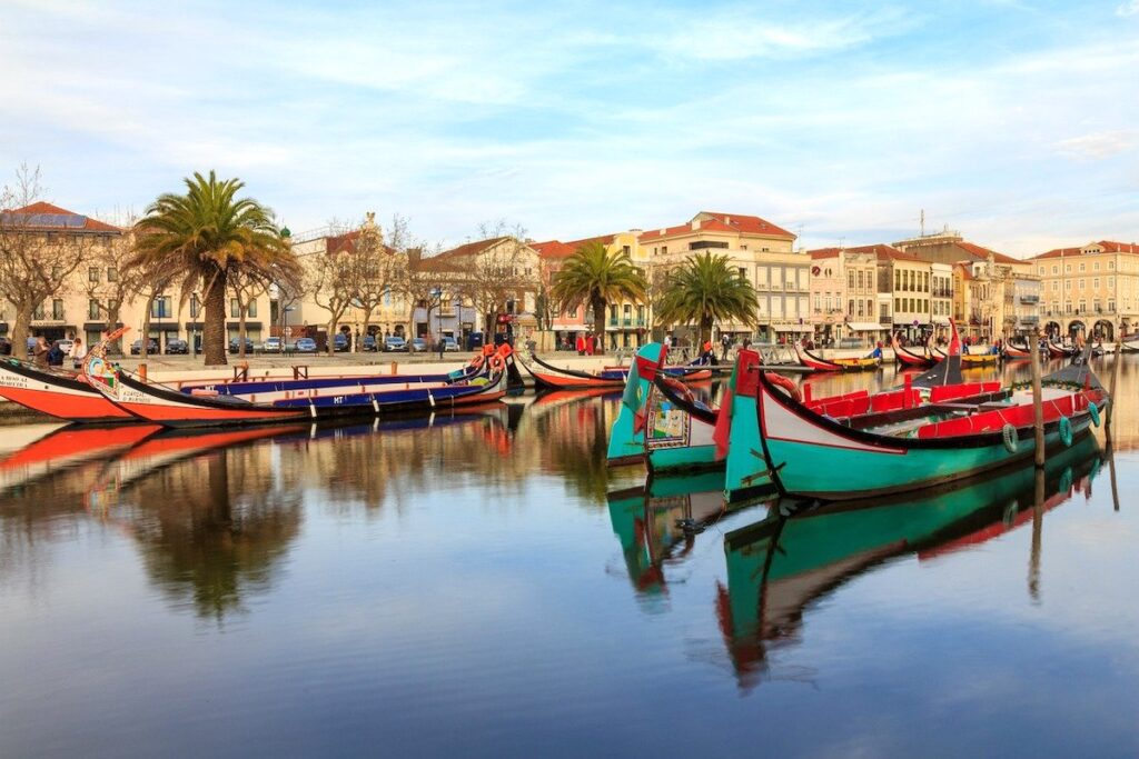 Green, red and yellow painted boats in Aveiro Portugal