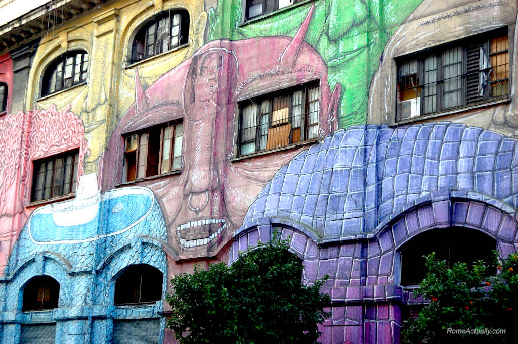 Mural on a building of multi coloured heads