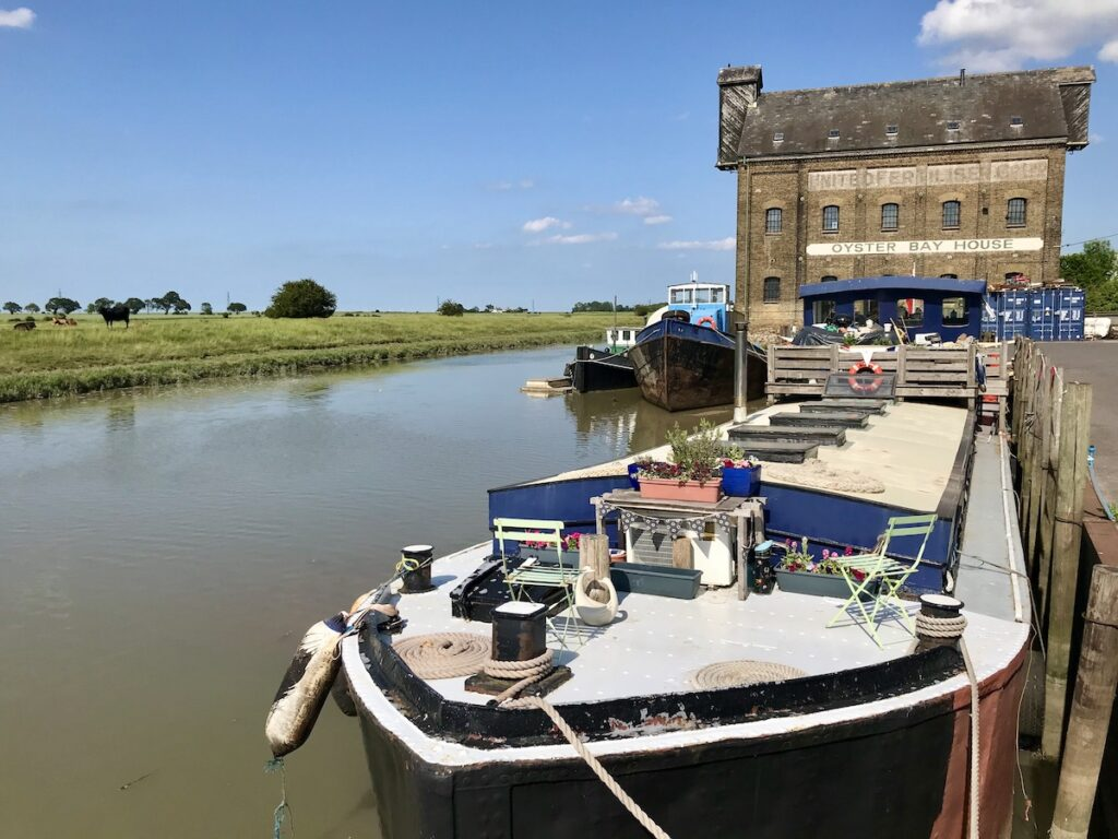 barge on the Faversham creek with a building in the foreground