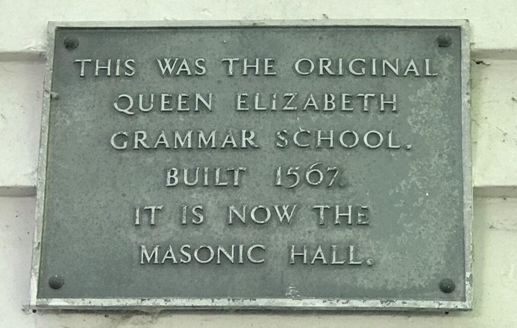 plaque describing the original site of queen Elizabeth grammar school