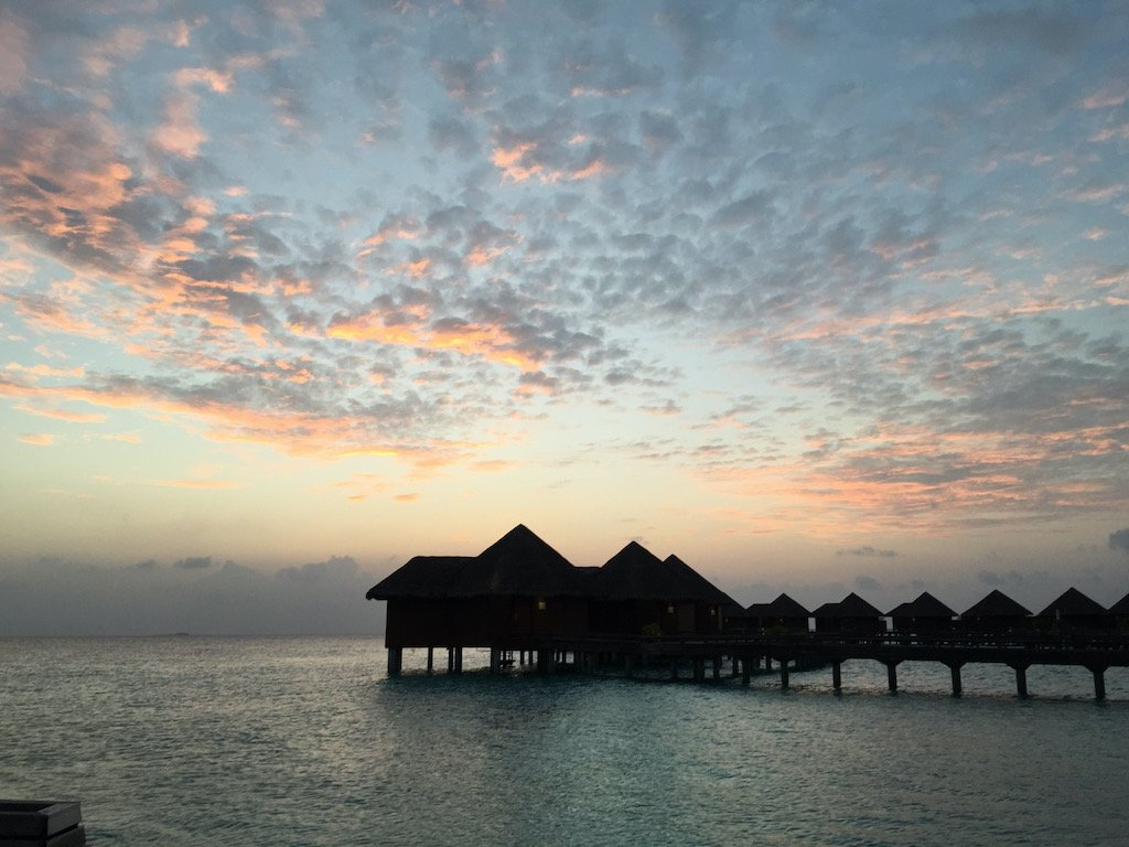 A sunset above the overwater villas