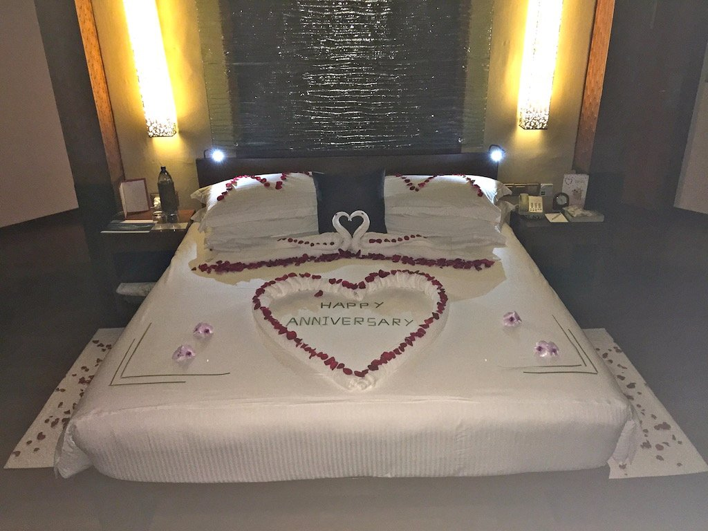 a bed with the message happy anniversary