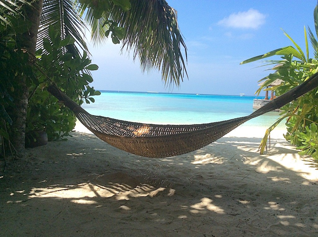 A straw hammock the beach