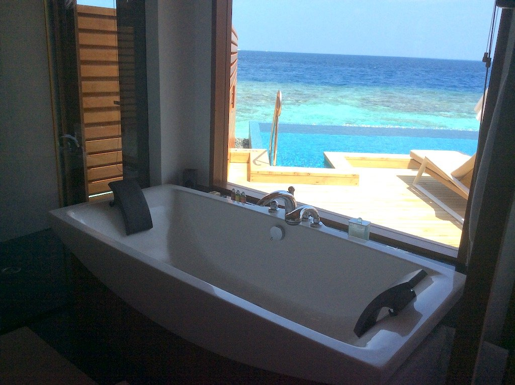 the bathroom looking out onto the ocean at Baros