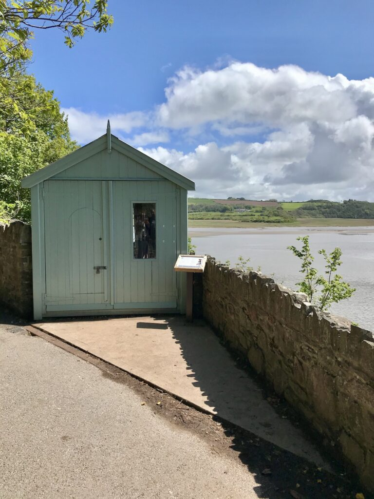 The green exterior of Dylan Thomas' writing shed overlooking the Taf Estuary