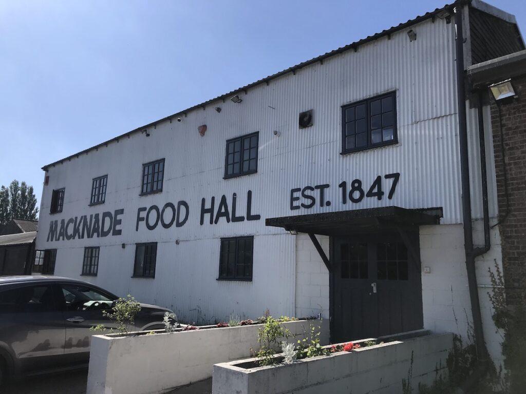 White and black exterior of Macknade food Hall in Faversham