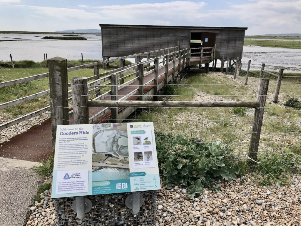 A bird-watching hide with information panel in Rye Harbour