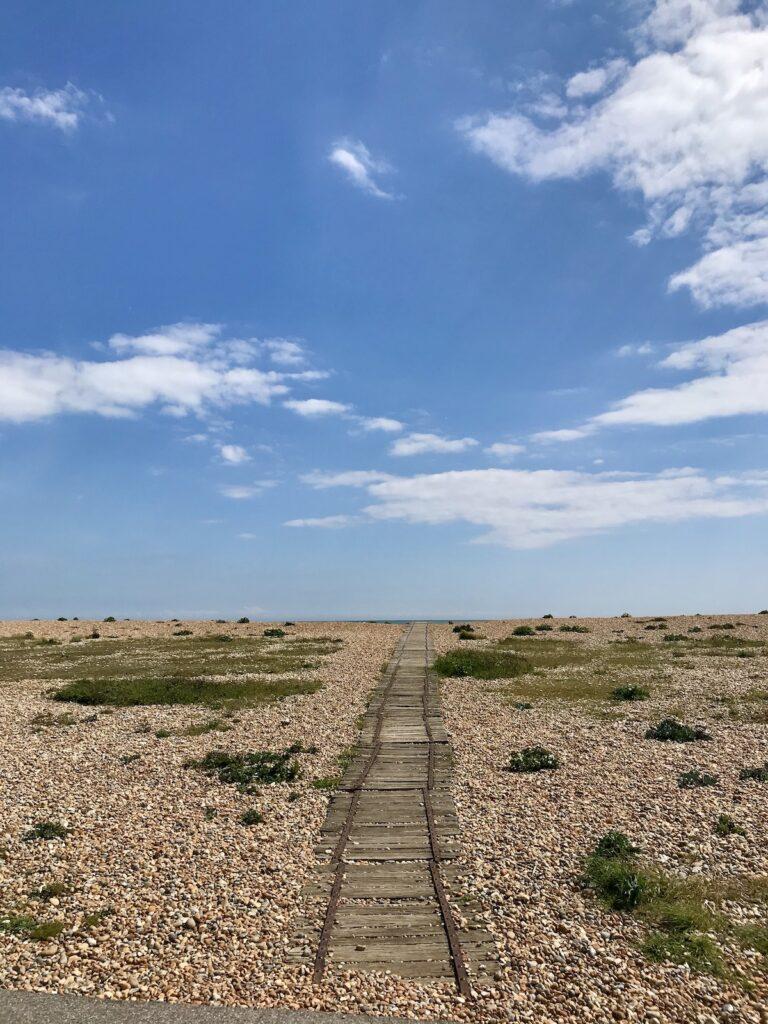 a long track leading across the shingle beach to the sea