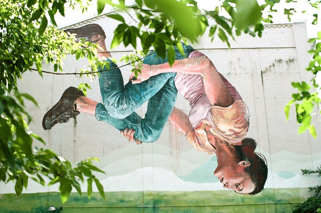 Street art in Kyiv depicting a girl upside down