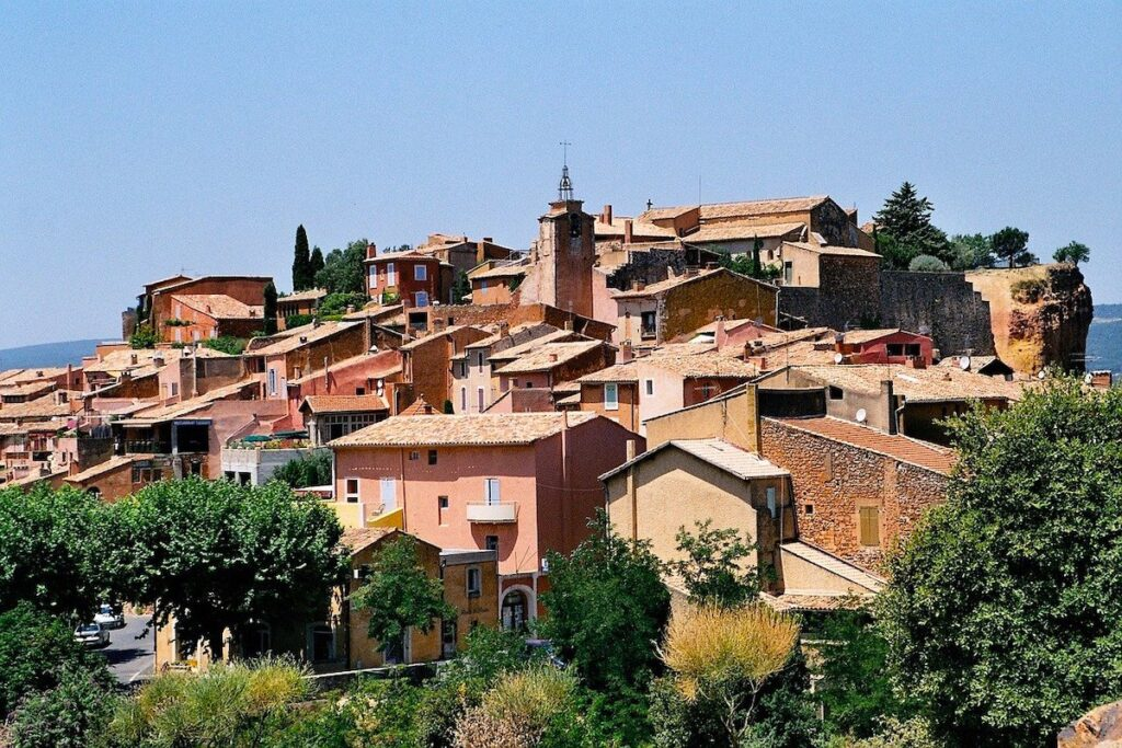 Ochre red buildings and rooftops of the mountain village of Rousillon