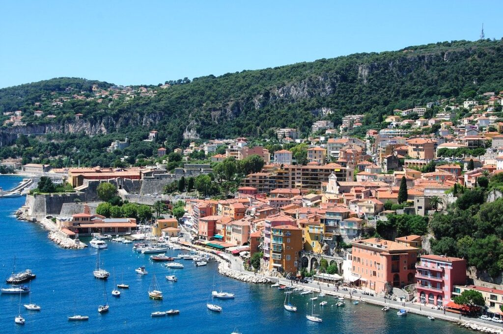 view of the coastline of Villefrance with its multicoloured buildings and harbour in the south of France