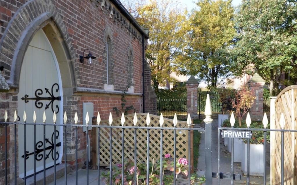 exterior of the Chapel showing original arched chapel door