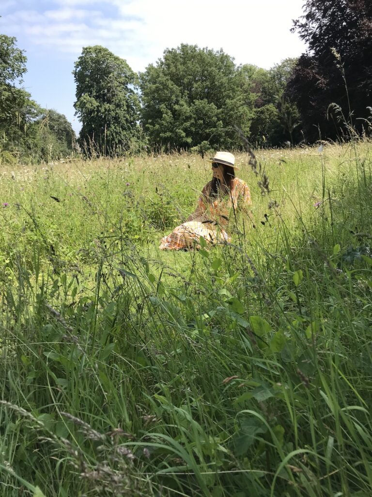Angie sitting in the wildflower meadow