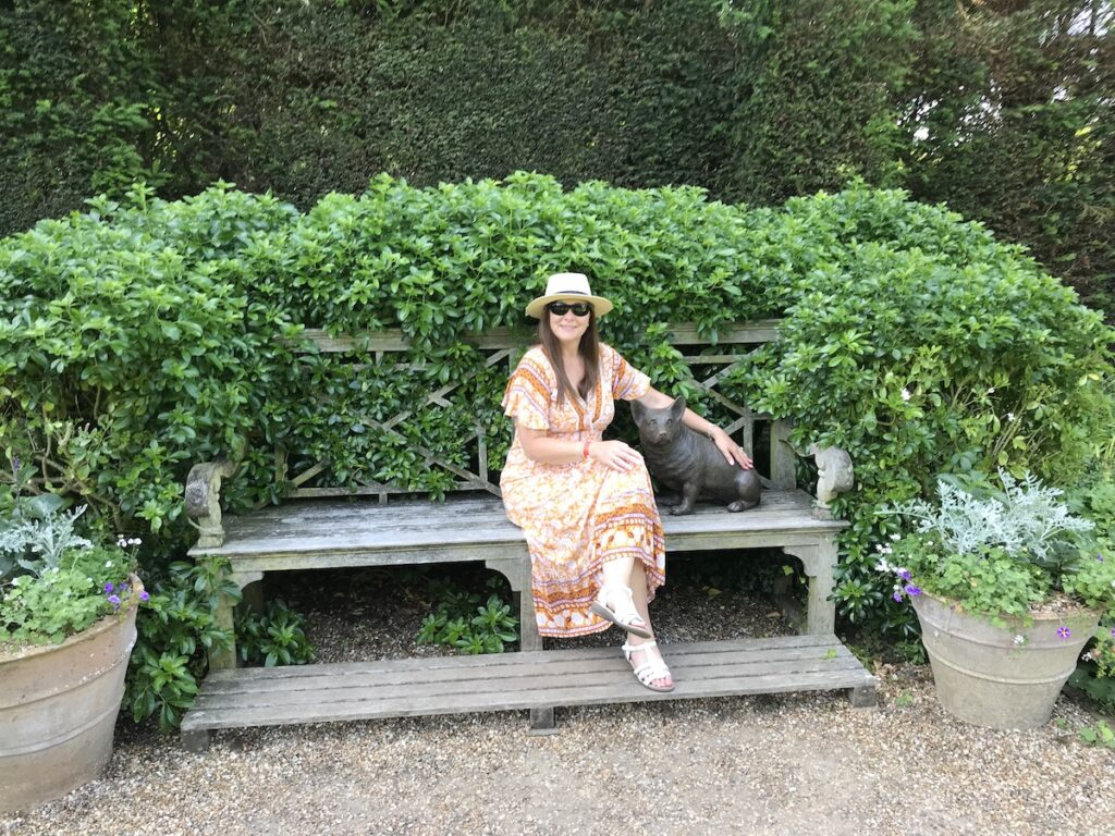 Bench with bronze corgi and Angie in a yellow dress
