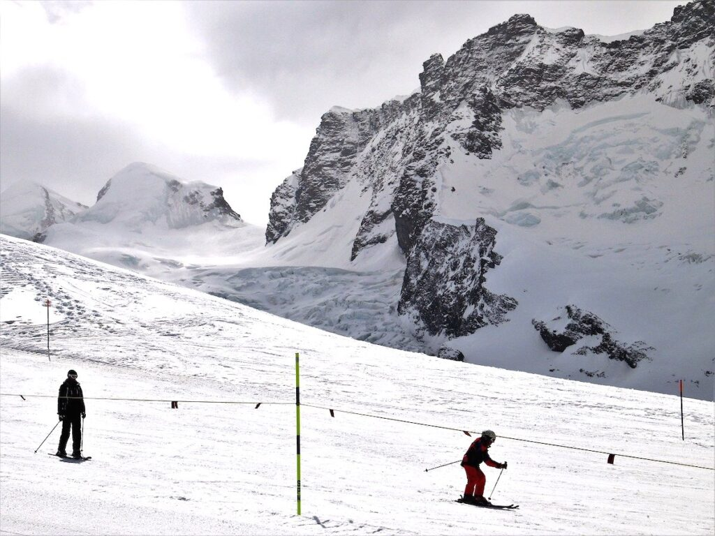 A view of two skiers on the mountains in the ski resort of Zermatt