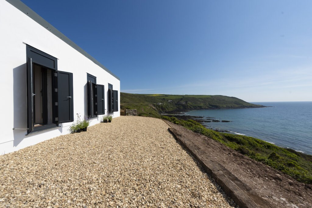 Exterior of cliffside hideaway with views to sea