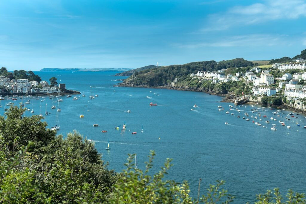 aerial view of Fowey harbour mouth with sailing boats