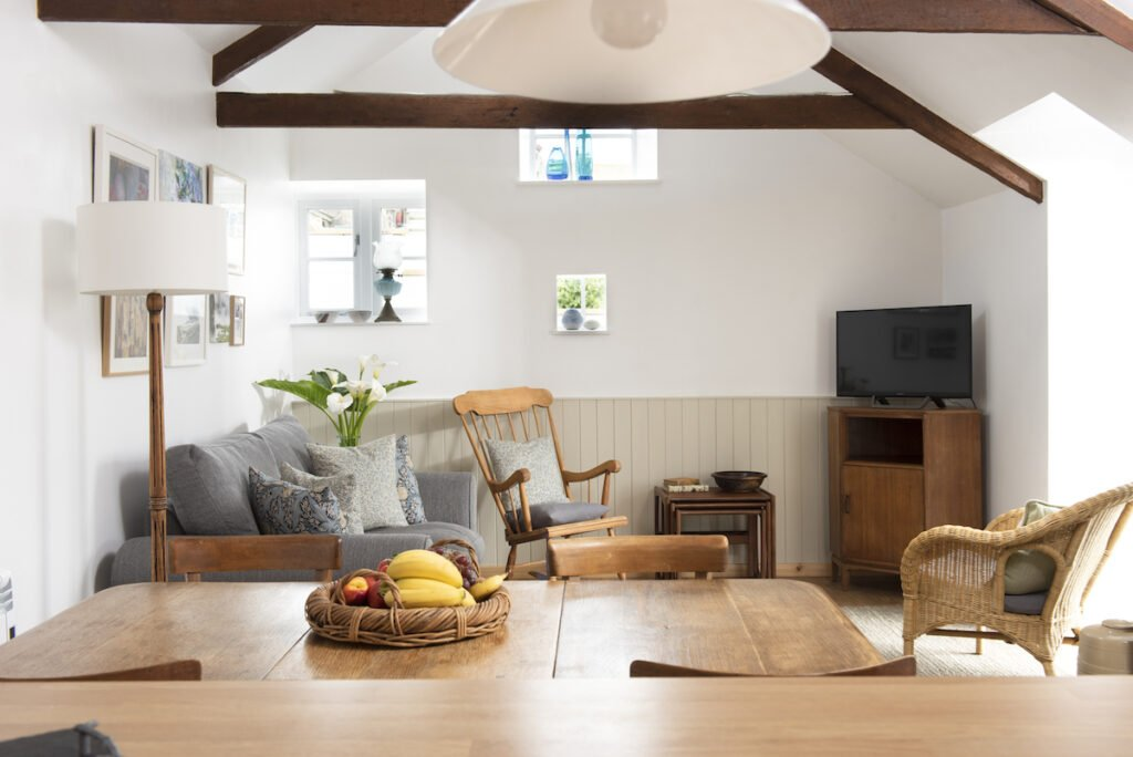 Living space with chair and tables in the Pigsty