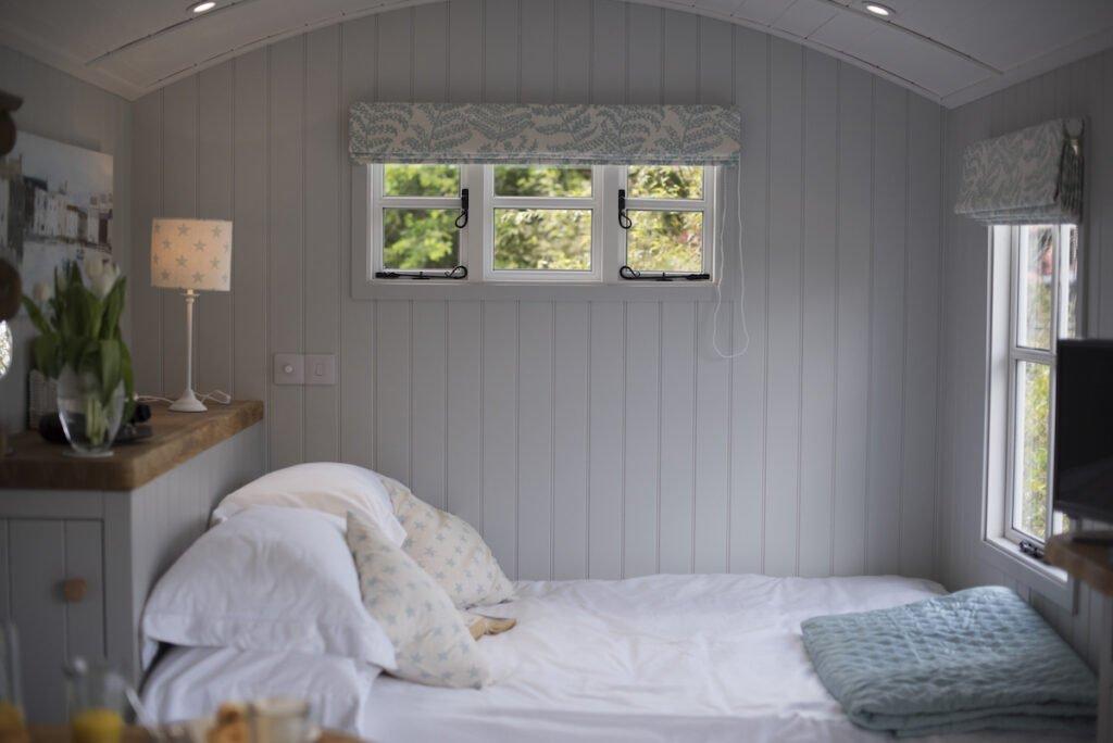Bedroom in Shepherd's Hut featuring panelled walls