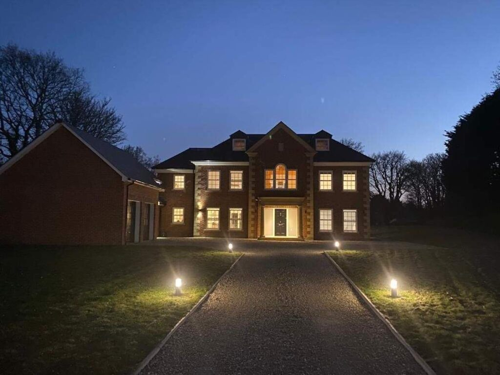 Willow House lit up at night